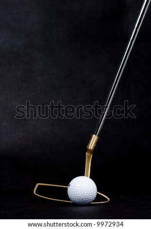 golf ball and putter dark background - stock photo