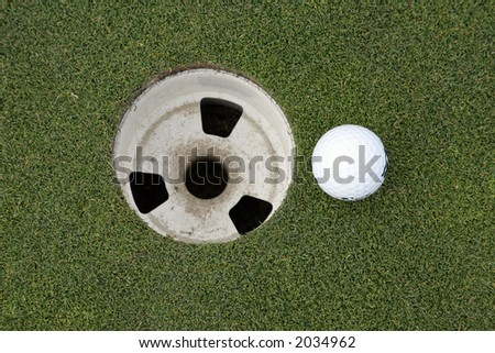 golf ball and putting green