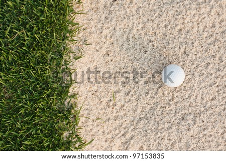 Golf ball  and sand bunker - stock photo