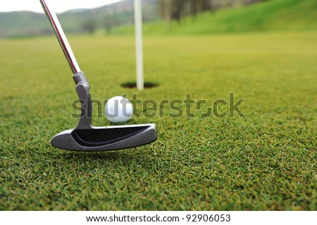Golf ball and stick on green grass - stock photo