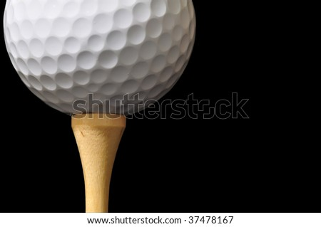 golf ball and tee isolated on black - stock photo