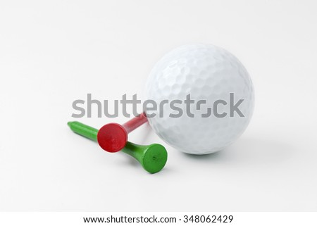 golf ball and tee on white background