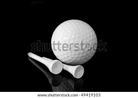 golf ball and tees black background