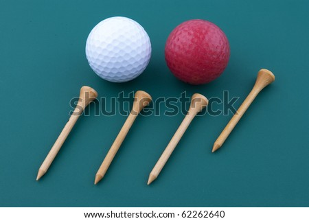 Golf ball and wood tee - stock photo