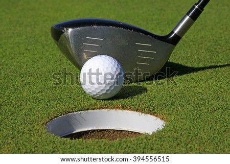 golf ball arm, closeup of photo - stock photo