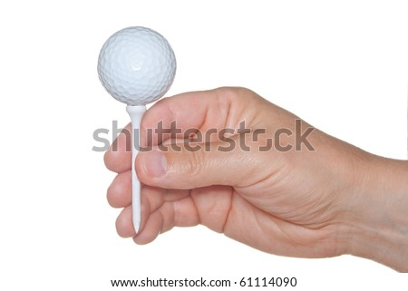 Golf ball at tee in hand isolated on white. - stock photo