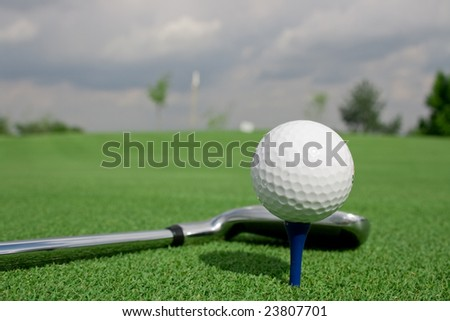 Golf ball club and tee pin