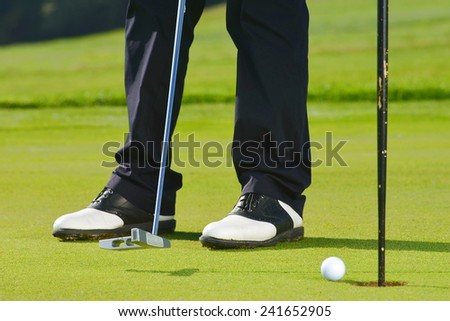 Golf Ball, Golfer and Club  - stock photo