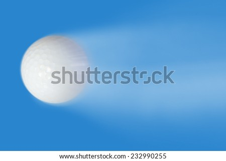 Golf ball high speeds on a blue background. - stock photo