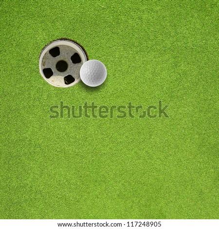 golf ball hole on a field - stock photo
