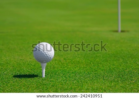Golf ball in a course and hole. Golf green. - stock photo