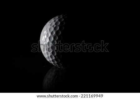 Golf ball in black background - stock photo