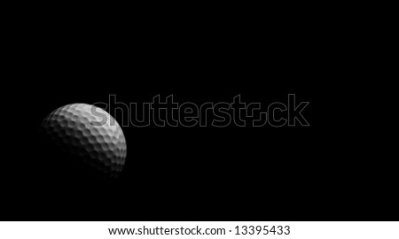 Golf ball in blackness with soft light.