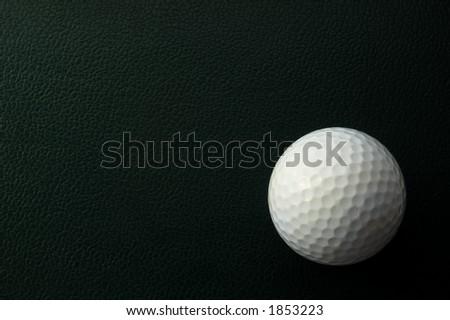 golf ball in corner of green background - stock photo