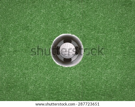 golf ball in golf cup on green - stock photo