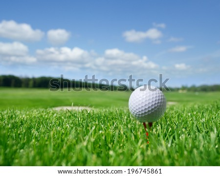 Golf ball in grass - stock photo