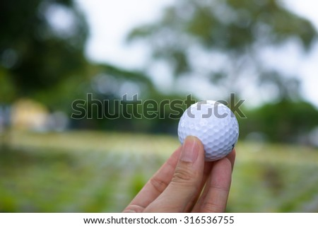 Golf ball in his hand - stock photo