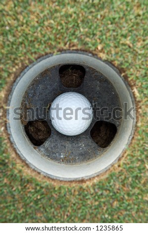 golf ball in hole - stock photo