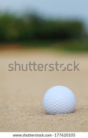 golf ball in sand bunker - stock photo