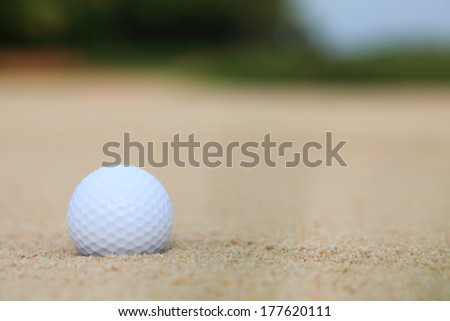 golf ball in sand bunker - stock photo