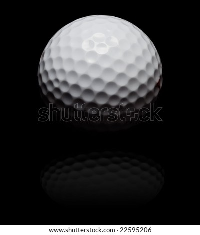 golf ball in spot light on black (with reflexion) - stock photo