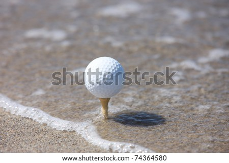 golf ball in the beach - stock photo