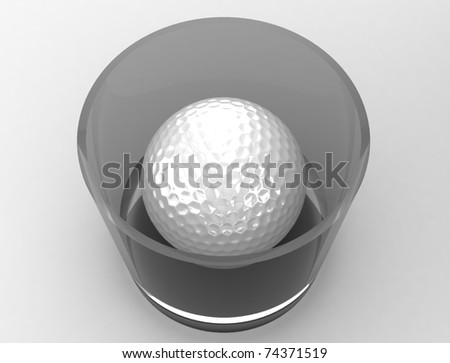 golf ball in whiskey glass - stock photo