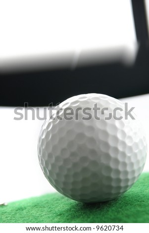 Golf ball. Iron hitting golf ball in motion