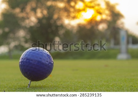 Golf ball is on the tee. - stock photo