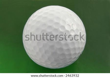 Golf ball macro on green surface - stock photo
