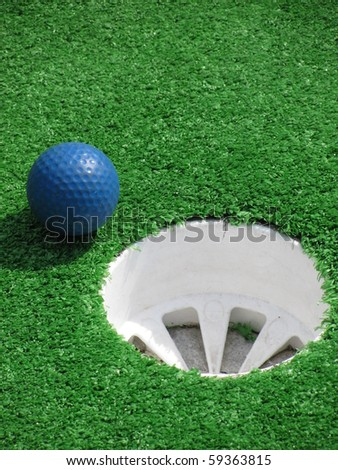 Golf Ball Near Hole - stock photo