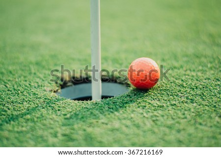 golf ball  of the hole hole green putting. - stock photo