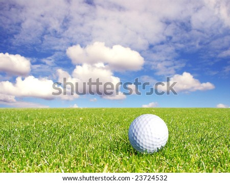 Golf ball on a golf course - stock photo