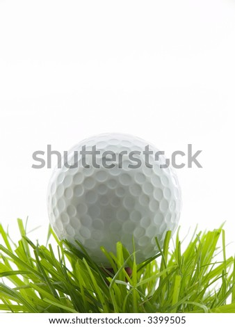 Golf ball on a tee in grass - stock photo