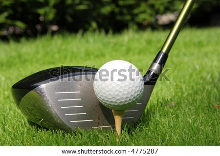 Golf ball on a tee with driver