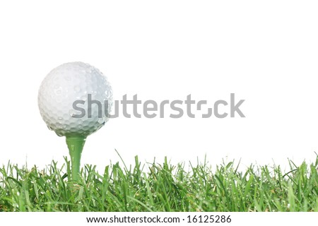 Golf ball on a tee with grass and white background in damp conditions. - stock photo