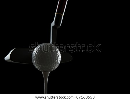 Golf ball on black background with copy space - stock photo