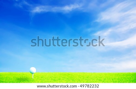 Golf ball on grass under blue sky with High-light processing - stock photo