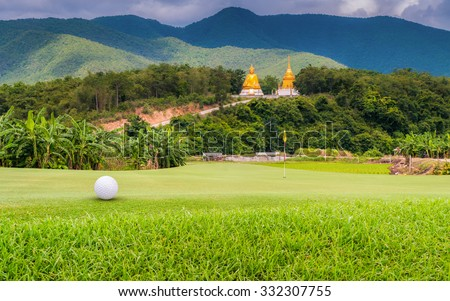golf ball on green. - stock photo
