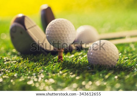 Golf ball on green at sunset