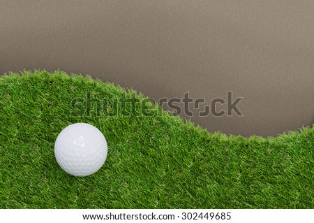 Golf ball on green grass of golf course with clipping path.