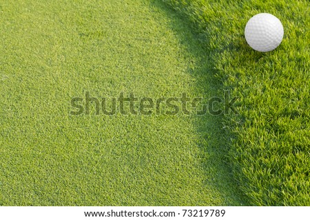 Golf ball on green tee.Golf sport is Balance of Yin Yang.Paste the text into the space  right hand side