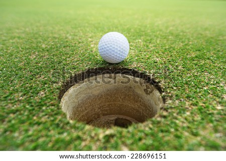 golf ball on hole - stock photo