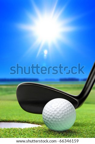 golf ball on lip near bunker, lovely beautiful golf course - stock photo