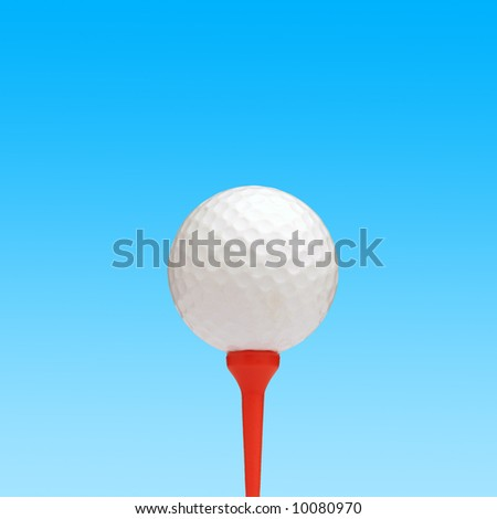 Golf ball on red tee against simulated sky background