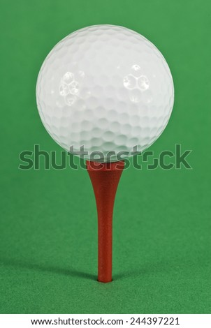 Golf Ball On Red Tee With Green Background Vertical Shot - stock photo