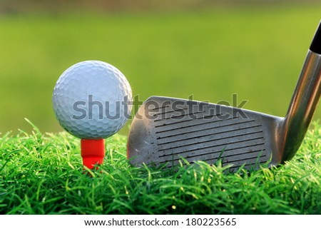 Golf Ball on tee and Steel Driver - stock photo