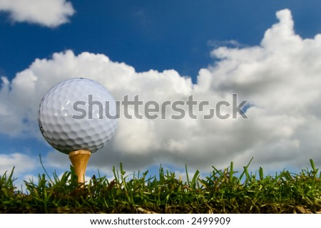 golf ball on tee from ground level