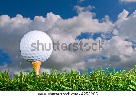 golf ball on tee from low angle - stock photo