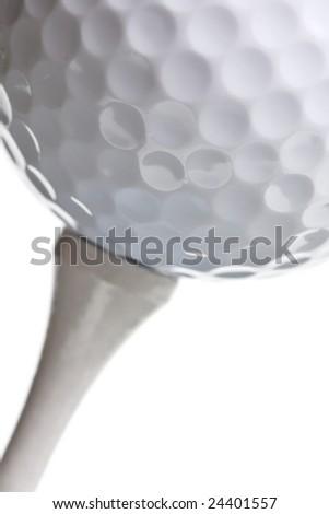 golf ball on tee isolated on white - stock photo